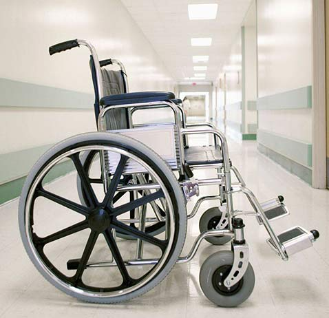 Wheelchair in a hospital hall waiting for its owner